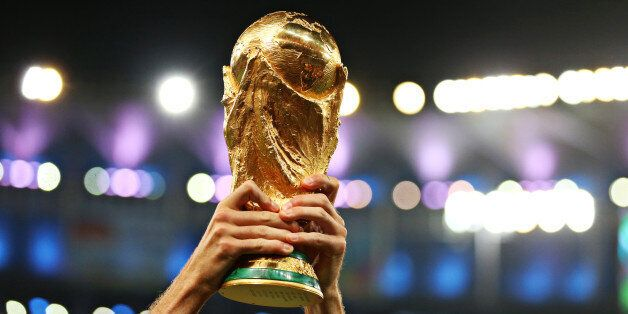 Detail of a Germany player lifting the FIFA World Cup