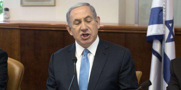Israeli Prime Minister Benjamin Netanyahu gestures as he chairs the weekly cabinet meeting in Jerusalem...