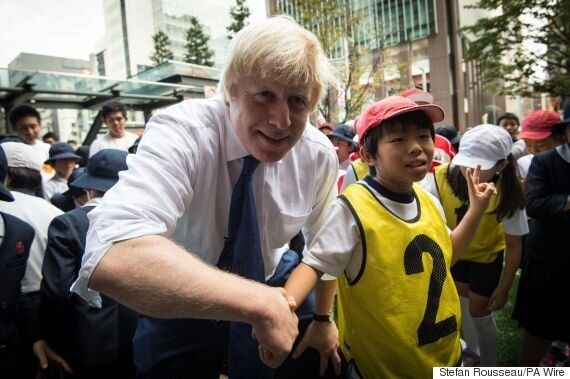 Boris Johnson Brutally Takes Out Japanese School Boy During Rugby Demonstration On Tokyo