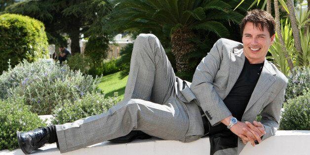 Scottish-American actor John Barrowman poses for photographers during the MIPTV (International Television...