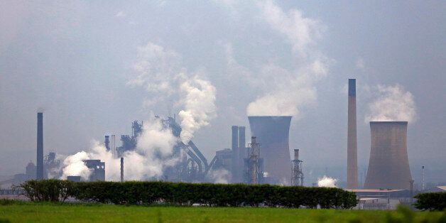 Vapor rises from cooling towers at the steel works operated by Tata Steel Ltd. in Scunthorpe, U.K., on...