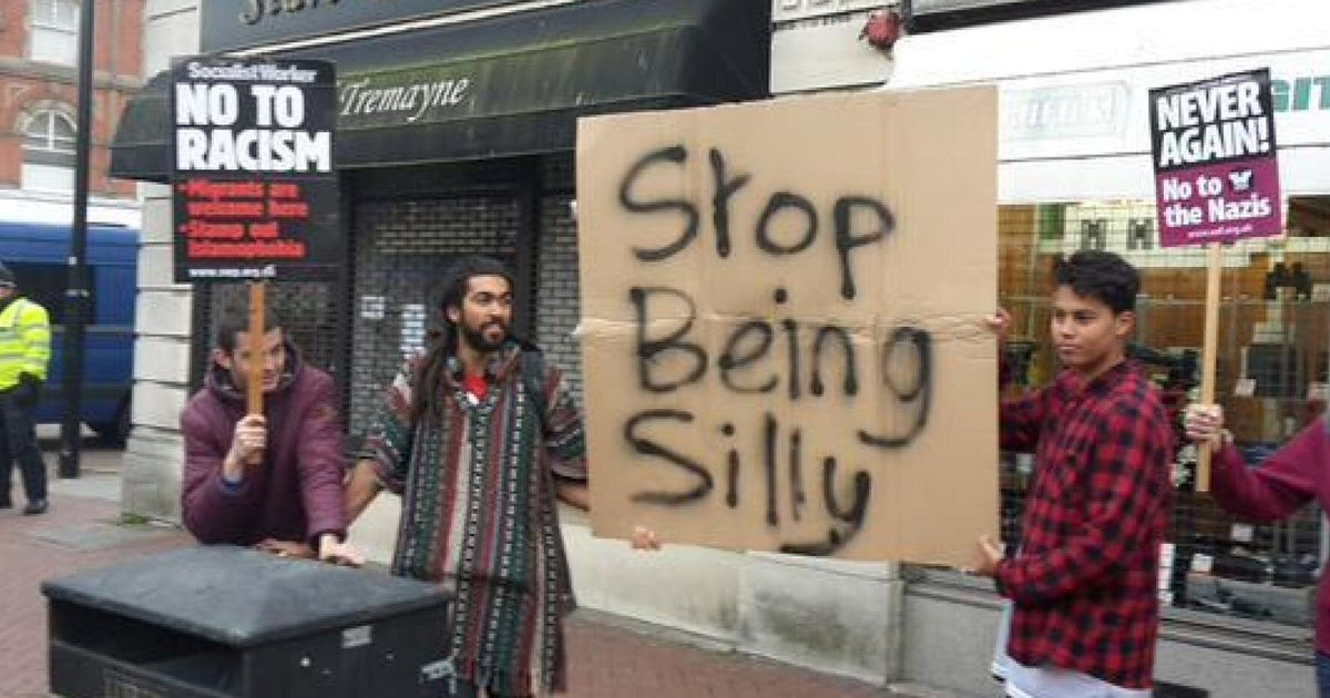 Britain First Anti-Mosque Demonstrators In Burton-Upon-Trent Told To 'Stop Being Silly' By Counter-Protest Sign