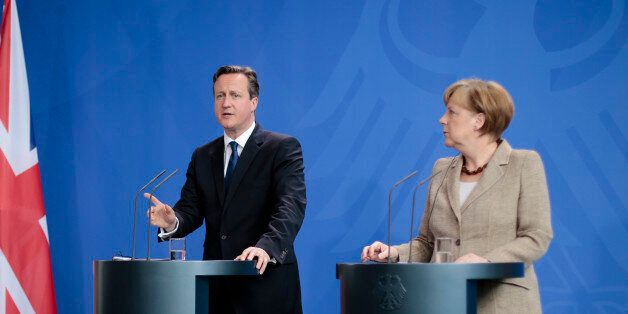 German Chancellor Angela Merkel, right, and British Prime Minister David Cameron (AP Photo/Markus