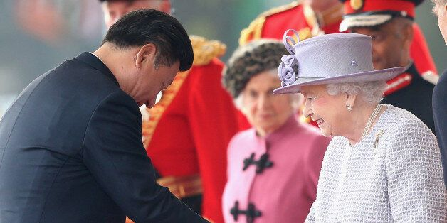 LONDON, ENGLAND - OCTOBER 20: Queen Elizabeth II shakes hands with Chinese President Xi Jinping on Horseguards...