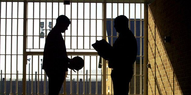Young offender (left) gets instruction in the tunnel before playing football at the privately-run Ashield...