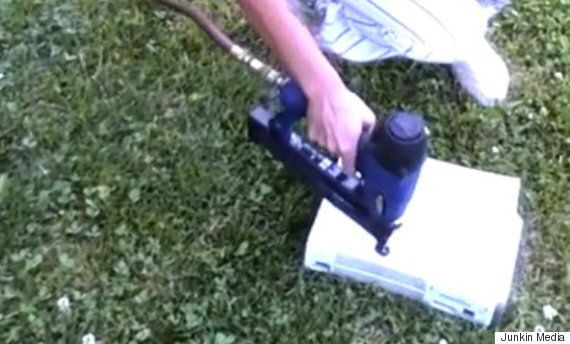Watch This Wife Calmly Nailgun Her Husband's Xbox To 'Improve