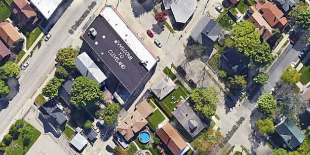 Artist Paints 'Welcome To Cleveland' On His Roof. He Lives Next To Milwaukee