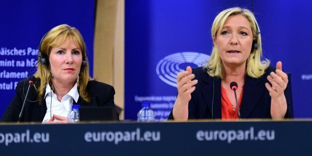 France's far-right National Front (FN) party leader Marine Le Pen (R) holds a press conference at the...