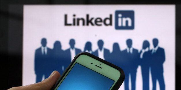 The LinkedIn Corp. logo is displayed on the screens of an Apple Inc. iPhone 6 and a laptop in this arranged...