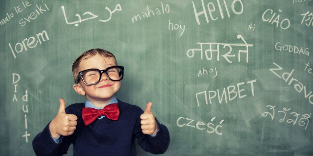 A young language master boy knows how to say hello in many different languages. All languages and cultures...