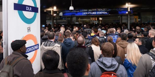 Commuters at Stratford Underground, Overground and DLR Station in east London, on the first day of a...