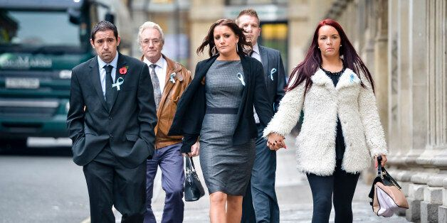 Friends and family of Becky Watts, including her grandfather, John Galsworthy (second left), wear blue...