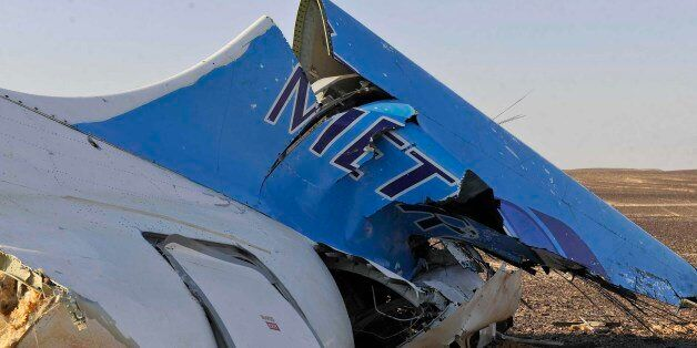 Image released by the Prime Minister's office shows the tail of a Metrojet plane that crashed in Hassana,