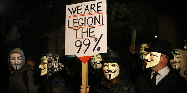 Protestors demonstrate outside Leinster House in Dublin as part of a planned Anonymous Million Mask March...