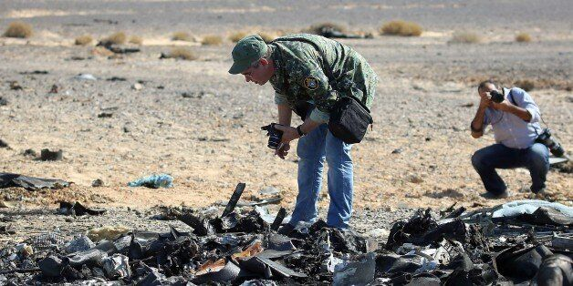 Egyptian officials inspect the crash site of Russian Airliner in Suez, Egypt on November 01, 2015. A...
