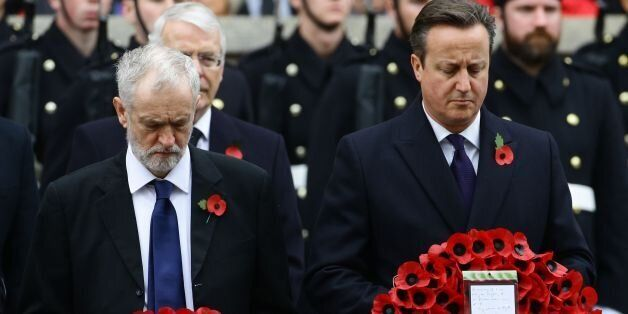 Labour party leader Jeremy Corbyn (left) and Prime Minister David Cameron wait to lay wreaths during...