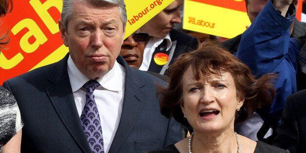 LONDON, ENGLAND - APRIL 28: Olympics Minister Tessa Jowell and Home Secretary Alan Johnson (L) meet locals...