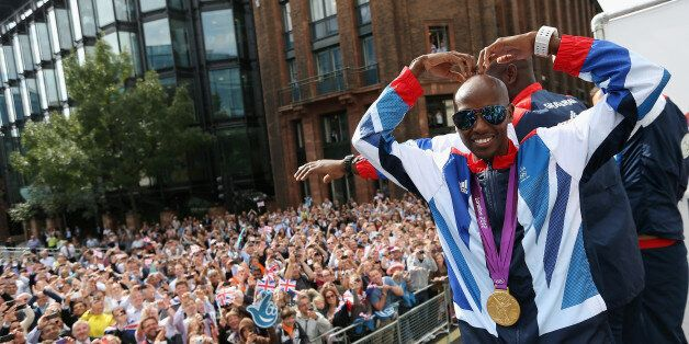 Mo Farah performs a mobot during the London 2012 Victory Parade for Team GB and Paralympic GB