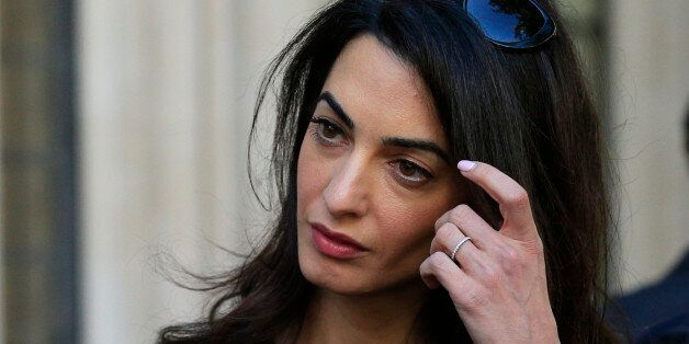 Amal Clooney leaves the Supreme Court in London, as she is part of the legal team representing former...