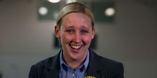 SNP's Mhairi Black smiles after defeating Labour's Douglas Alexander for the Paisley and Renfrewshire...