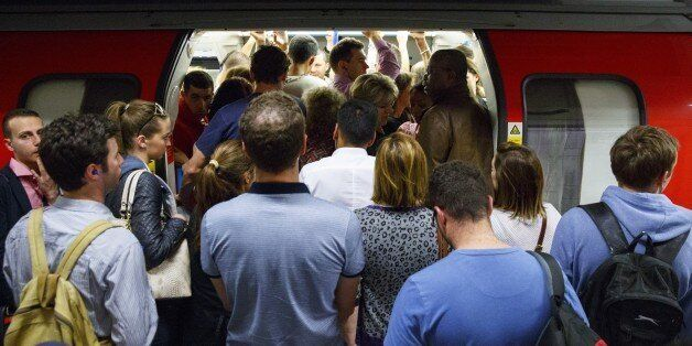 LONDON, UNITED KINGDOM - JULY 08: Commuters queuing for tube trains at Green Park Tube Station ahead...