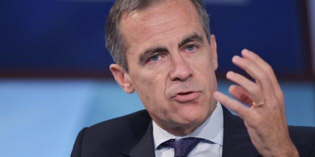 Bank of England Governor Mark Carney speaks during a discussion on ethics and finance at the 2014 IMF...