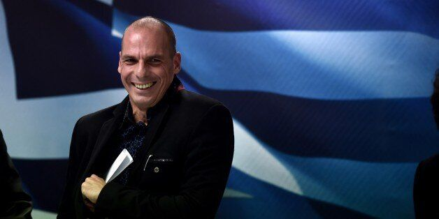 Greece's new Finance minister Yanis Varoufakis smiles after a ministry hand-over ceremony in Athens on...