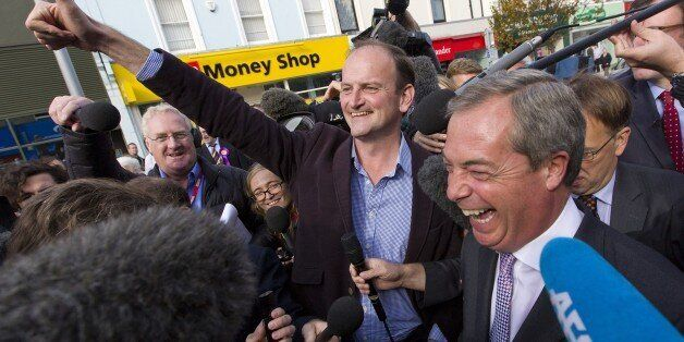 Newly elected UK Independence Party (UKIP) MP Douglas Carswell (C) and party leader Nigel Farage (R)...