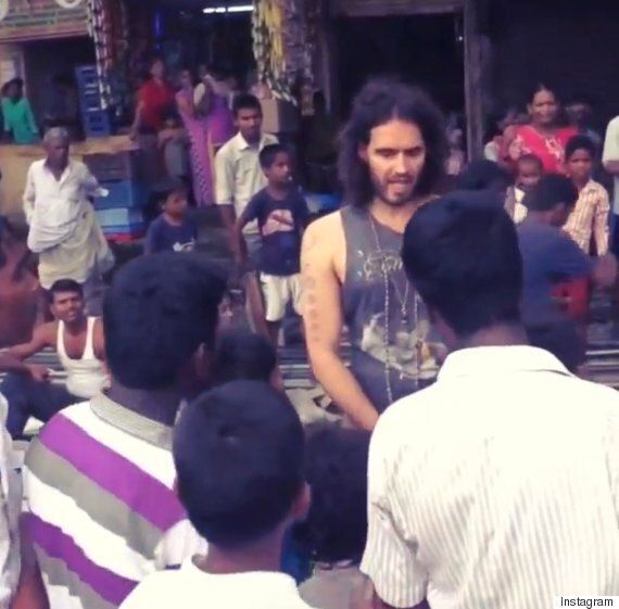 Russell Brand's Phone Gets Stolen While Visiting Slums In India, And Then This