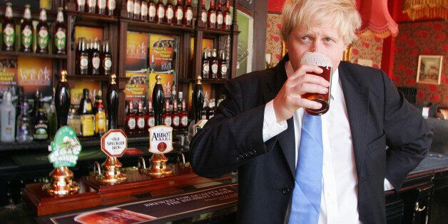 London Mayor Boris Johnson enjoys a pint of Greene King's Abbot Ale at the King's Arms pub on Tooley...