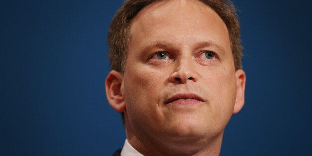 Party chairman Grant Shapps (C) addresses delegates at the Conservative party conference on September...