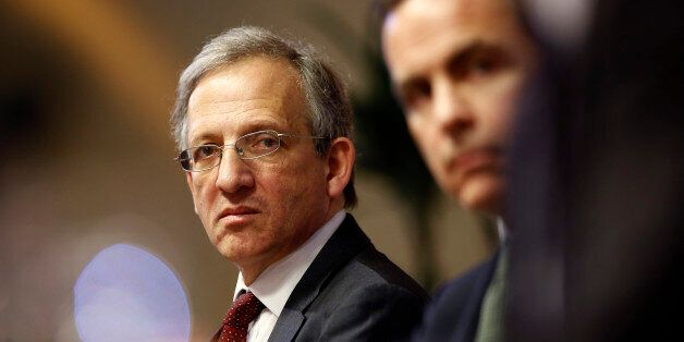 Jon Cunliffe, deputy governor for financial stability at the Bank of England, left, sits with Mark Carney,...