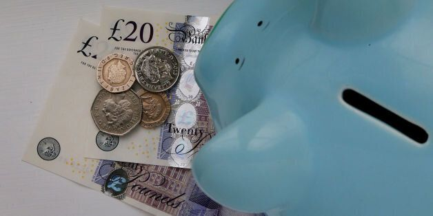 File photo dated 06/01/15 of money in a piggy bank, as the UK population is spending more and has a greater...