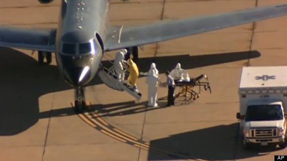Ebola Patient Transferred By Man In Suit And No Protective Gear In