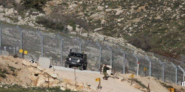 Israeli troops patrol the Israeli-occupied sector of the Golan Heights on the border with Syria after...