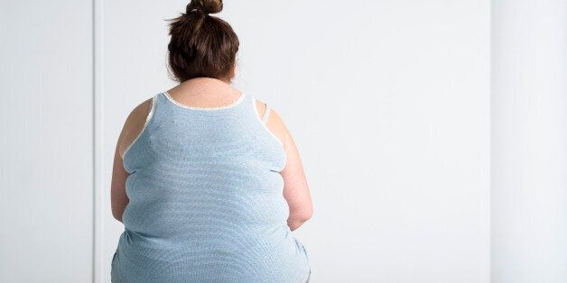 Teenaged overweight girl sitting at a