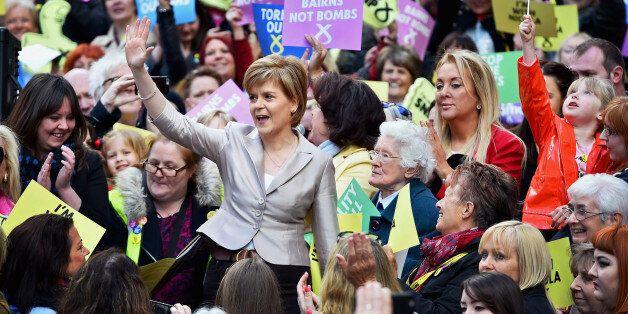 GLASGOW, SCOTLAND - APRIL 25: SNP Leader Nicola Sturgeon joins female activists in Buchanan Street SNP...