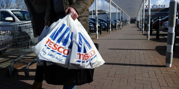 (FILES) In this file picture taken on March 5, 2012 people carry shopping bags through the carpark of...