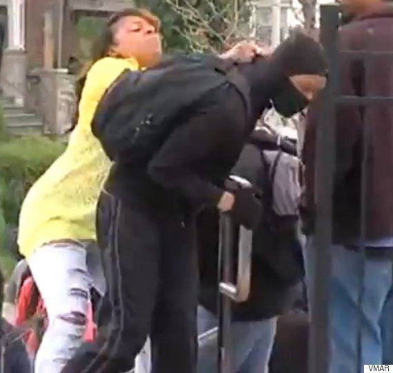 Baltimore Riots Video Captures Mother Marching Mask-Clad Son Home Live On