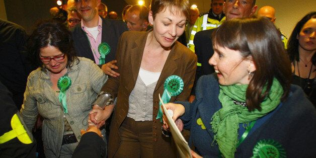 Caroline Lucas (centre) celebrates after becoming Britain's first Green Party MP after winning the Brighton...