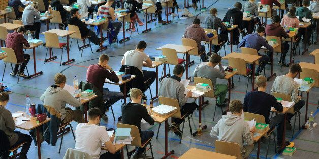 High school students sit at their tables during the final school leaving exams (Abitur) at the ecumenical...