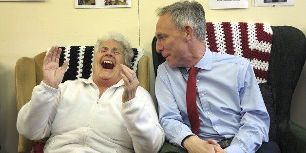 Leader of the Scottish Labour Party Jim Murphy (R) speaks with pensioner Margaret McLaughlin as he campaigns...
