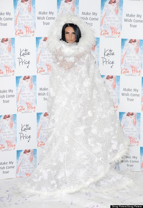 Katie Price Sports Flesh-Flashing Christmas Bride Look At Book Launch (PICS,