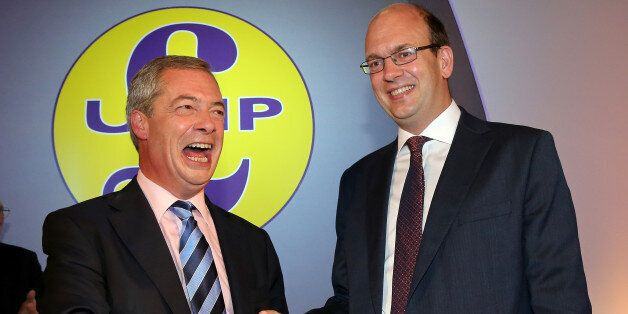 Conservative MP Mark Reckless (R) is welcomed to UKIP by party leader Nigel Farage after the tory MP...