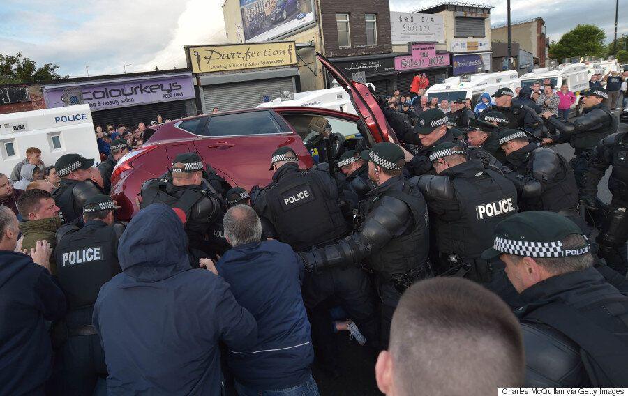 Belfast Orange Parade Turns Violent As Police Lift Car Off Teenage