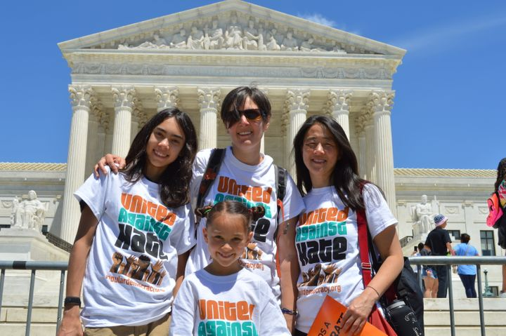 Ali Wicks stands with her family in front of the Supreme Court.