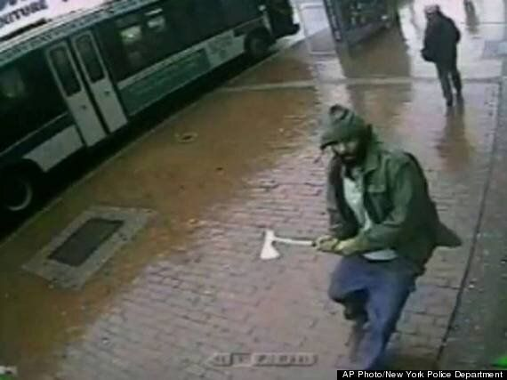 Axe-Wielding Man Attacks Police Officers In New York Captured On CCTV