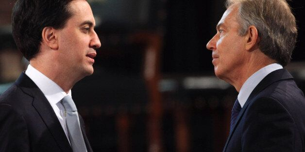 Leader of the Labour party Ed Miliband and former British Prime Minister Tony Blair speak before Queen...