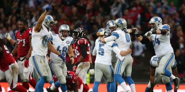 LONDON, ENGLAND - OCTOBER 26: Matt Prater #5 of the Detroit Lions celebrates with team mates after kicking...