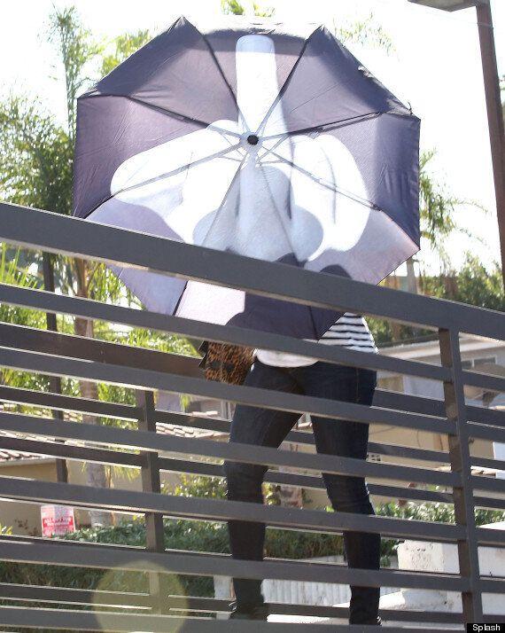 Jennifer Lawrence Gives Photographers The Middle Finger Via Her Umbrella Following Chris Martin Split